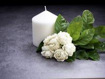 Jasmine and candles on dark background stock photos