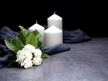 Jasmine and candles on dark background royalty free stock photography