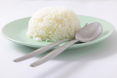 Jasmine cooked rice with spoon and fork Stock Photos