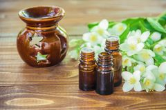 Jasmine essential oil. Selective focus stock image