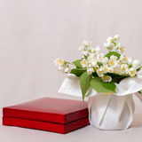 Jasmine flowers in a vase and present box. Jasmine flowers in a vase with a textile coating and present box Stock Images