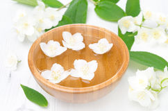 Jasmine flowers in a wooden bowl for spa and aromatherapy Royalty Free Stock Photos