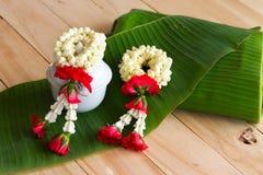Jasmine garland of flowers on banana leaf background. Stock Images