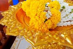 Jasmine garland on gold plate Stock Photos