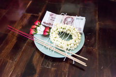 Jasmine garland, incense, favorable thread and money in Tray Stock Images