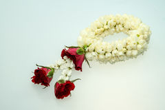 Jasmine garland and roses Royalty Free Stock Images