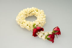 Jasmine garland and roses Stock Photography