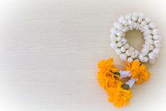 jasmine garland thai style on yellow Stock Photo