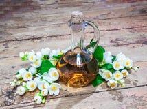 Jasmine oil, flowers. Jasmine oil concept spa with jasmine flowers on an old wooden surface. Aromatherapy. Retro style stock photos