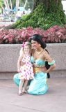 Jasmine Poses with Little Girl at Epcot Royalty Free Stock Photos