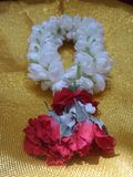 Jasmine and red rose garland in golden background Stock Photos
