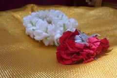 Jasmine and red rose garland in golden background Stock Photography
