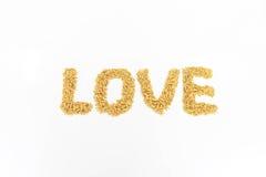 Jasmine rice arranged as alphabetically love. Jasmine rice is placed on a white background Stock Photos