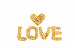 Jasmine rice arranged as a heart shape. Jasmine rice is placed on a white background Royalty Free Stock Photography