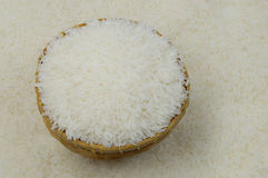 Jasmine rice. In basket on rice background Royalty Free Stock Photo