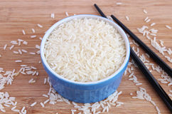 Jasmine rice in blue bowl Stock Images