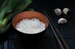 Jasmine Rice Bowl with Chopstick on Black Bamboo Mat Stock Photos