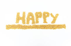Jasmine rice brought organized into Happy. Jasmine rice is placed on a white background Stock Photos