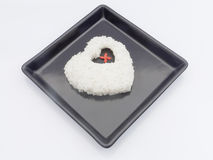 Jasmine rice heart shape on black dish Royalty Free Stock Images