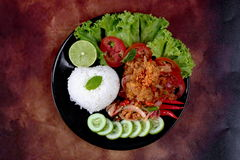 Jasmine rice with spicy fried chicken salad Khao Yum Kai Zap in Thai. As rice toppep spicy chicken salad,chili,tomato,red onion,roasted rice,dried chili Royalty Free Stock Images