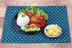Jasmine rice with spicy fried chicken salad Khao Yum Kai Zap in Thai served mixed vegetables salad. Jasmine rice with spicy fried chicken salad Khao Yum Kai Zap Royalty Free Stock Photos