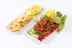 Jasmine rice with spicy fried chicken salad Khao Yum Kai Zap in Thai and side dish. Spicy fried chicken salad Yum Kai Zap in Thai as spicy chicken salad,chili Royalty Free Stock Photography