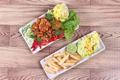 Jasmine rice with spicy fried chicken salad Khao Yum Kai Zap in Thai and side dish. Spicy fried chicken salad Yum Kai Zap in Thai as spicy chicken salad,chili Royalty Free Stock Photo