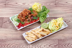 Jasmine rice with spicy fried chicken salad Khao Yum Kai Zap in Thai and side dish. Spicy fried chicken salad Yum Kai Zap in Thai as spicy chicken salad,chili Royalty Free Stock Photos