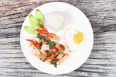 Jasmine rice topped stir - fried spicy basil with meat. Royalty Free Stock Images