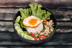 Jasmine rice topped stir - fried spicy basil with meat. Royalty Free Stock Image