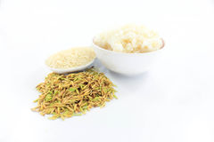 Jasmine rice on a white background. Rice is an important economic crop plants in Thailand and is also consumed as a staple food Stock Image