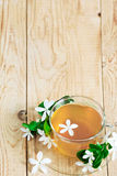 Jasmine tea background. Green tea with jasmine blossom. Copy space background Royalty Free Stock Photo