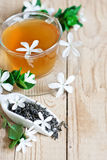 Jasmine tea background. Green tea with jasmine blossom. Copy space background. Selective focus Royalty Free Stock Photography