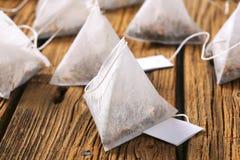 Jasmine tea bags. On wood Stock Photo