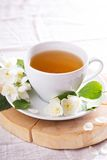Jasmine tea in a cup with fresh flowers Royalty Free Stock Photos