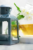 Jasmine tea in a glass tea pot on wooden background Royalty Free Stock Photo