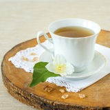 Jasmine tea. With jasmine herb flower on wooden table Royalty Free Stock Image