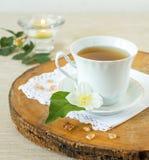 Jasmine tea. With jasmine herb flower on wooden table Stock Photos