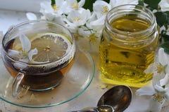 Jasmine tea with honey. On white wooden background Royalty Free Stock Photos