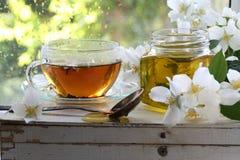 Jasmine tea with honey. On a wooden table Stock Photo