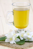 Jasmine tea and jasmine flowers Stock Photography