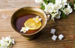 Jasmine tea with lemon in a cup stock photo