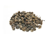 Jasmine tea pearls. Organic jasmine infused green tea pearls that are hand sewn on a with background Stock Images