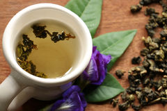 Jasmine tea in Thailand. Tea cup and dried tea leaves Royalty Free Stock Images