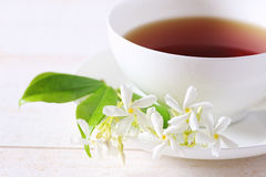 Jasmine tea in a white bone china cup. On white background. Focus selective royalty free stock image