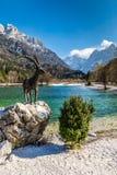 Jasna Lake,Mountain Range,Chamois Statue-Slovenia Royalty Free Stock Photo