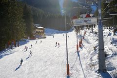 The skiers are on Biela Put slope in Jasna Low Tatras royalty free stock images