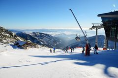The skiers and Rotunda cableway station on Chopok in Jasna Low Tatras royalty free stock photography
