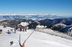 Skiers on a sunny day on Mount Chopok in the resort of Jasna. Royalty Free Stock Photo