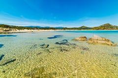 Jasna woda w Scoglio Di Peppino plaży Zdjęcie Stock